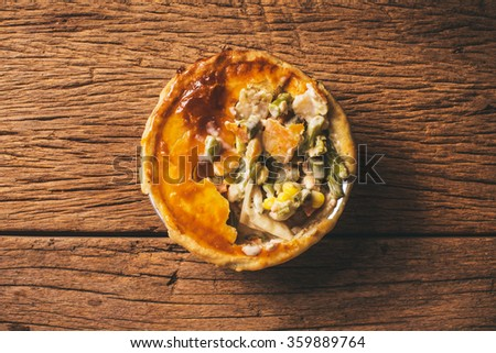 Chicken Pot Pie with Carrot, Asparagus and Corn, Delicious. Homemade Fresh Baked, Country Rustic Style. Wood Background. Selective Focus. - stock photo
