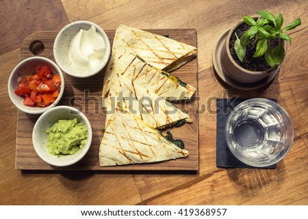 Chicken Quesadilla Mexican food on wooden table