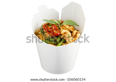 Chicken red curry in white wok package - stock photo
