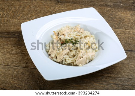 Chicken risotto with cheese and thyme branch - stock photo