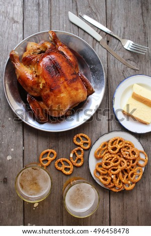 Chicken roasted and pretzels with beer in party