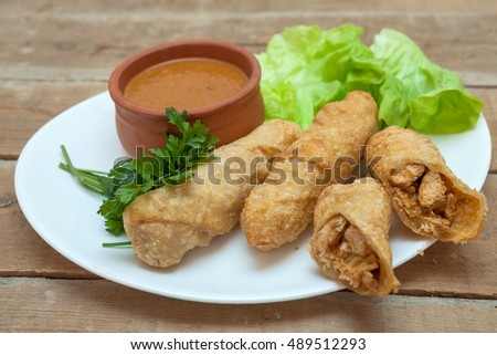 Chicken roll with sauce and vegetables