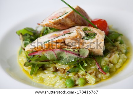 Chicken rolls with risotto stuffed with shrimps