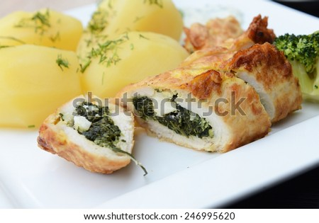 Chicken rolls with spinach and feta cheese - stock photo