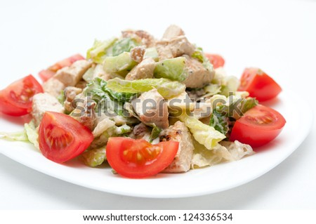 chicken salad with chunks of apple in a creamy sauce - stock photo