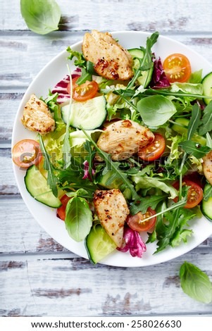 Chicken salad with leaf vegetables and cherry tomatoes  - stock photo