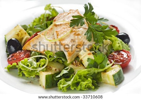 Chicken salad with lettuce and vegetables close up - stock photo