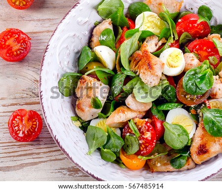 Chicken salad with vegetables and eggs. Healthy food. Top view