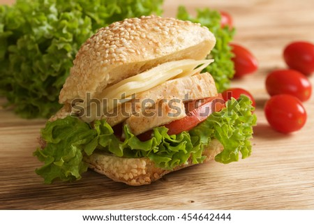 chicken sandwich on wooden background