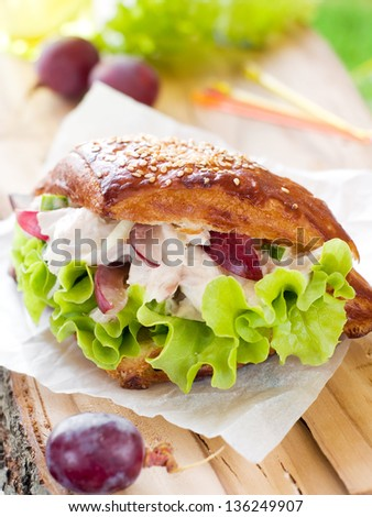Chicken sandwich with lettuce and grape, selective focus