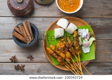 chicken satay popular asian dish top view - stock photo