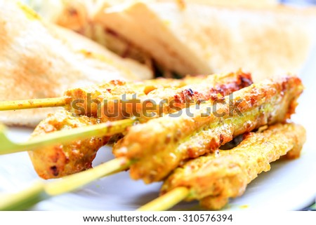 Chicken satay, the famous food in southeast asia. - stock photo