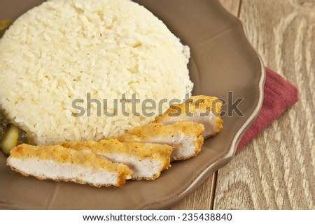 Chicken schnitzel with Turkish Pilav Rice - stock photo