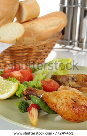 Chicken served with salad and bread