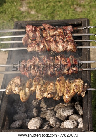 Chicken shashlik in preparation at barbecue - stock photo