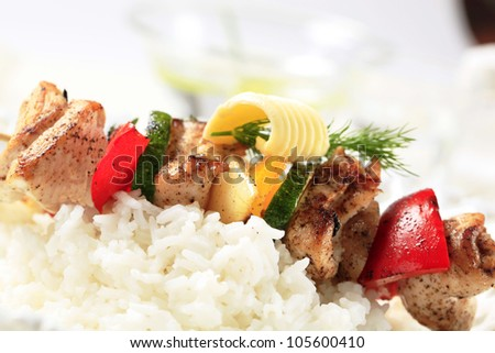Chicken shish kebab on bed of white rice  - stock photo