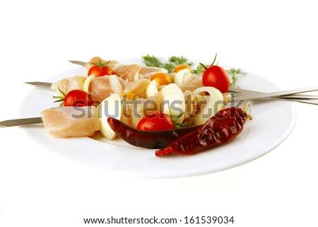 chicken shish kebab served on white plate - stock photo