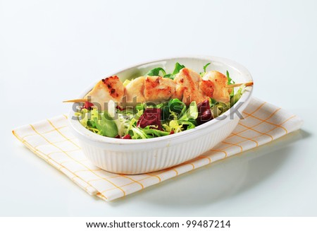 Chicken skewer and salad mix  - stock photo