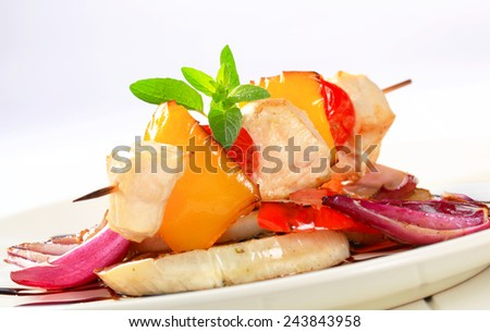 Chicken skewer with pan roasted vegetables and balsamic vinegar