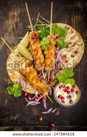 Chicken skewers and vegetable dipping sauce. top view. selective focus - stock photo