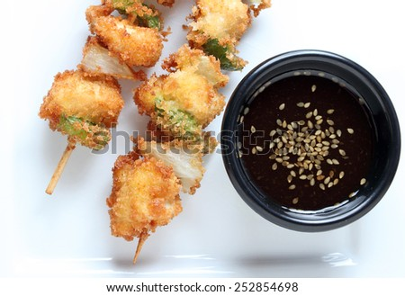 Chicken skewers on plate with dipping sauce. - stock photo