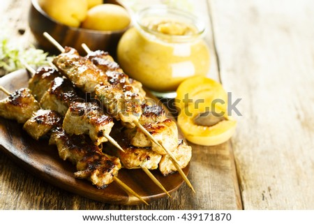 Chicken skewers with apricot sauce - stock photo