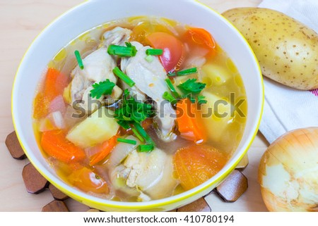 Chicken soup chicken soup with vegetables in a bowl  - stock photo