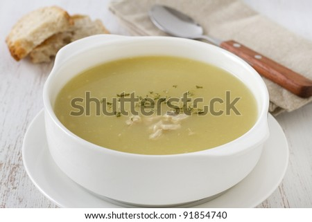 chicken soup in the white bowl - stock photo
