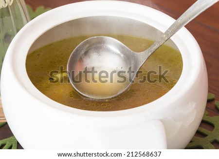 Chicken soup on the wooden table