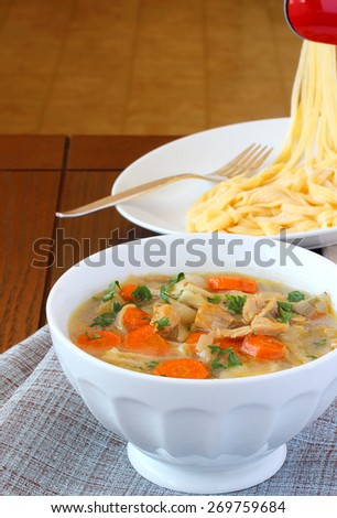 Chicken soup with fresh homemade noodles - stock photo