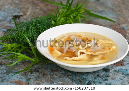 chicken soup with homemade noodles - stock photo