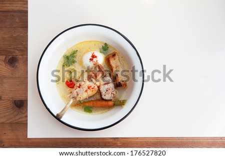 Chicken soup with noodles, crouton, egg and vegetables a - stock photo