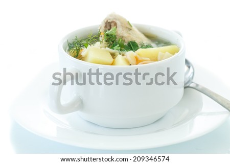 chicken soup with noodles in a bowl on a white background - stock photo