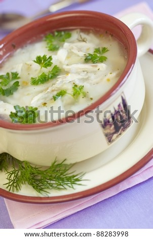 Chicken soup with potatoes and rice - stock photo