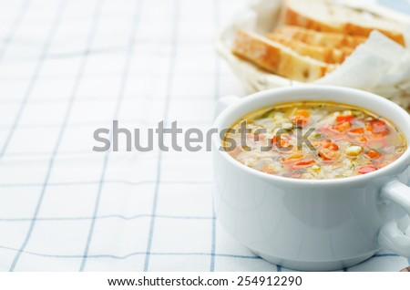 chicken soup with rice and peppers on a light background. tinting. selective focus