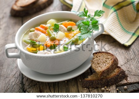 Chicken soup with vegetables - stock photo