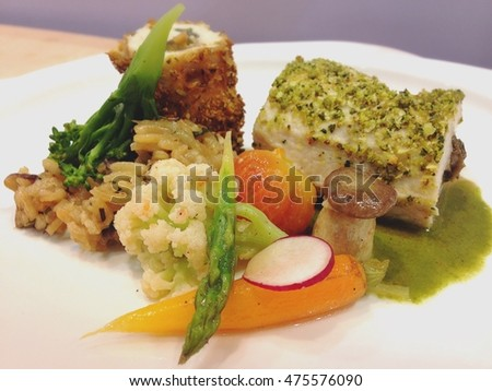 Chicken steak served with grilled vegetables