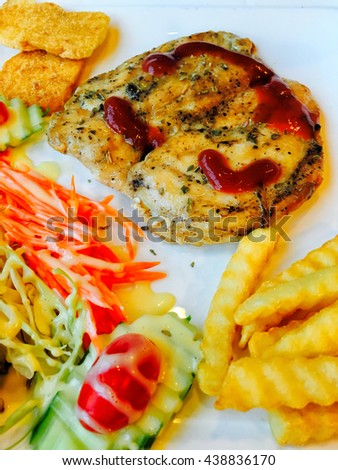Chicken steak set with side dishes - stock photo