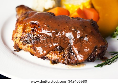 chicken steak with black pepper sauce and vegetable - stock photo