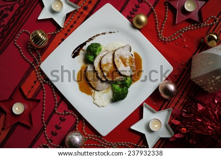 Chicken steak with Christmas decoration. - stock photo