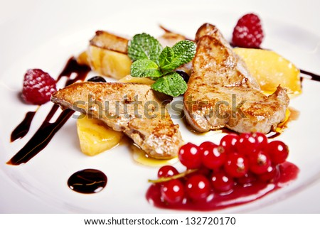 Chicken steak with fruits and berries served on plate - stock photo