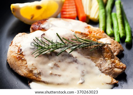 chicken steak with rosemary and sauce