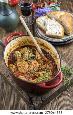 Chicken stew in casserole - Poulet Basquaise - stock photo
