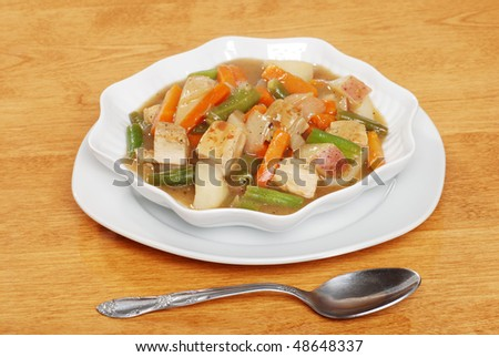 chicken stew with a spoon - stock photo
