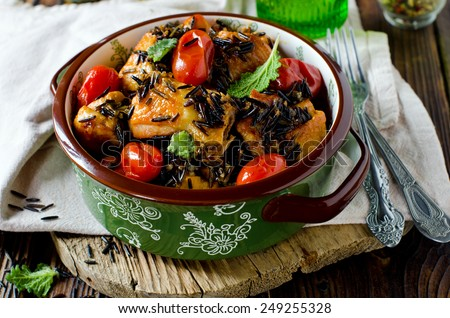 Chicken stew with cherry tomatoes and wild rice - stock photo