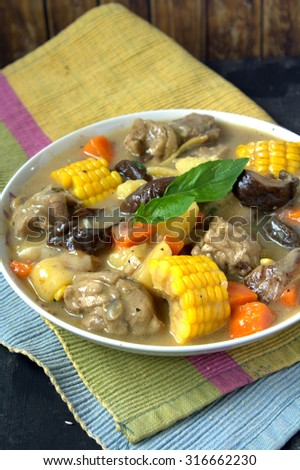 Chicken stew with corn, mushroom, carrot and potato  - stock photo