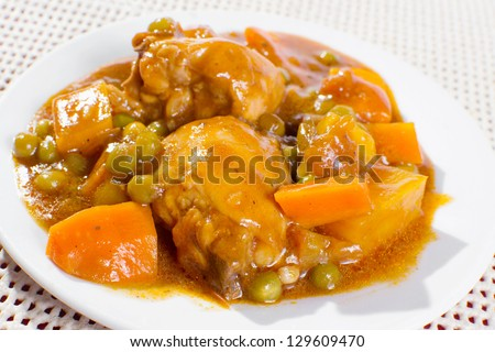 chicken stew with potatoes, carrots, green peas in tomato sauce.