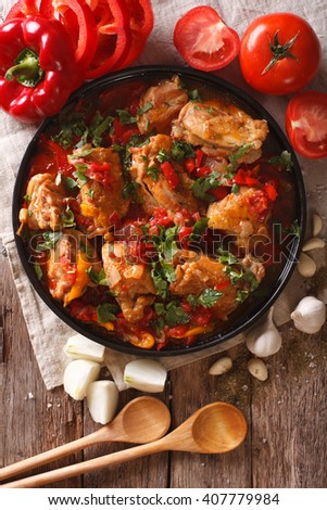 chicken stew with vegetables on a table close-up. vertical view from above - stock photo