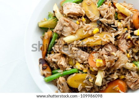 chicken stir fry with farm fresh vegetables and brown rice, a very healthy meal - stock photo