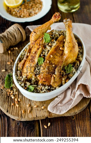 Chicken stuffed with rice and pine nuts - stock photo